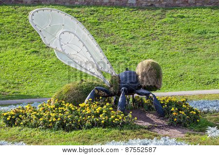 Landscaping. Figure Bee In The Park By The River Tsna