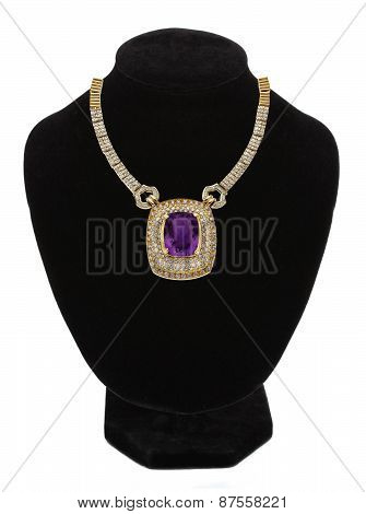 Beautiful Gold Jewellery Necklace With Violet Stone On Black Mannequin Isolated On White