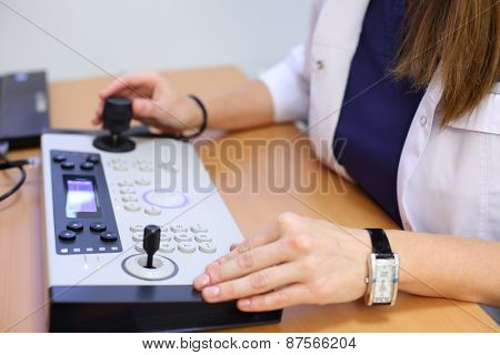 Close-up of medical worker hands on the keyboard panel