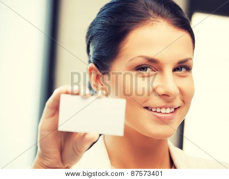 bright picture of confident woman with business card
