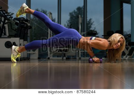 Healthy Middle Age Woman Doing Push Up Exercise