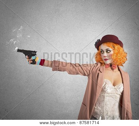 Clown thief shoots whit gun still smoking poster