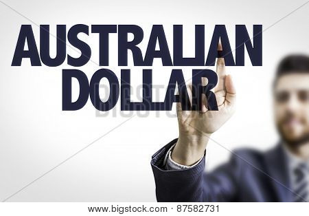 Business man pointing the text: Australian Dollar