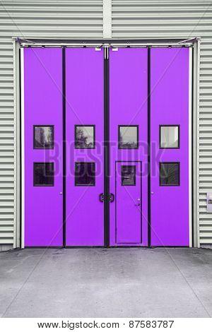 Purple Garage Door on a warehouse building