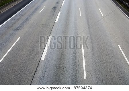 Pattern Of Empty Highway In Grea With Median Stripes