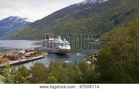 FLAAM, NORWAY - JUN 9 2015 : A cruise ship waits for returning passengers on the Aurlandsfjord.