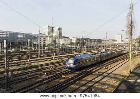 MUNICH, GERMANY - JULY 3, 2015: View from the Hackerbrueck on the station platform where trains arrive and depart in the background is the building of the central bus station in Munich and the Bayerische Rundfunk building