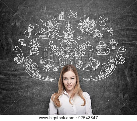 Young Woman Is Dreaming About Shopping. Shopping Icons Are Drawn On The Black Chalkboard.