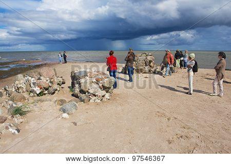 People enjoy the sea view at the Kolka cape in Kolka, Latvia.