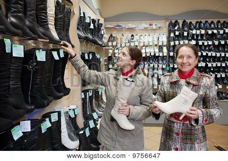 Women Shopping At Fashion Shoe Store