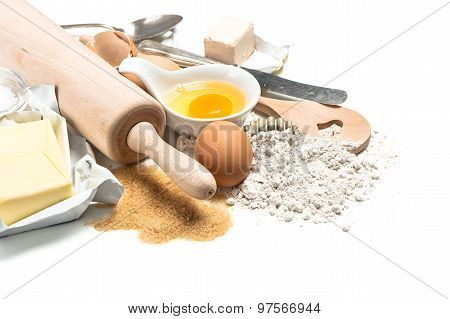 Baking Ingredients Flour, Eggs. Wooden Kitchen Utensils. Food Background