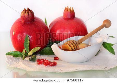 symbols of holiday of Rosh Hashanah, traditional jewish food, honey and pomegranate poster
