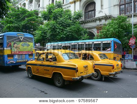 Yellow Ambassador Taxi Cars Go On The Street In Kolkata