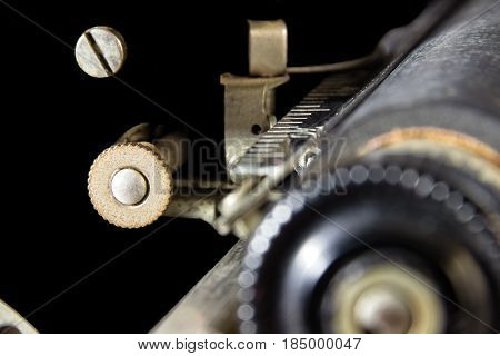 A Relic: An Outer Space Wannabe. Abstract of the gears and screws of a 1930's typewriter that seems to float in the blackness of space. Suitable for multiple business and industrial applications; business office, hotel and motel wall decoration.