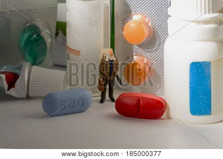 Drugs pharmacy and elder man. Blue and red pills. Old man shops for medical drugs. Drugs against sickness or illness concept. Elder man seeking for health. Senior age people problem illustration