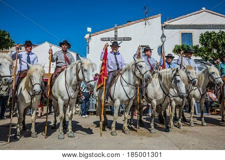 Sent-Mari-de-la-Mer, Provence, France - May 25, 2015. Square in the center of the city. World Festival of Gypsies. Guards on white horses lined up before the start of the parade