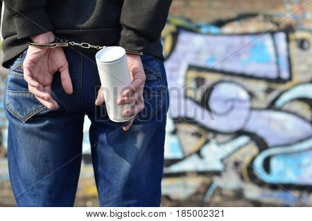 Young Hoodlum Caught By The Police And Shackled In Handcuffs With Spray Can