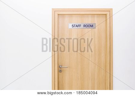 door with label staff only sign room in office concept for business