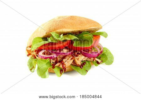 Sandwich with pulled pork, salad and tomato isolated on white background