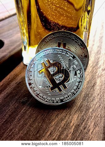 Digital currency physical silver bitcoin coin on wooden table