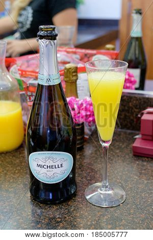 EUGENE, OR - SEPTEMBER 3, 2016: Michelle Prosecco mimosas at a wedding reception.