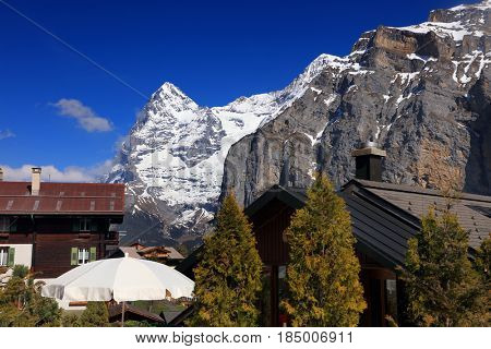 Traditional Swiss House and Alps mountains on background in Murren, Switzerland, Europe