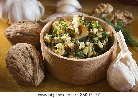 Garlic dip sauce with walnuts and ingredients