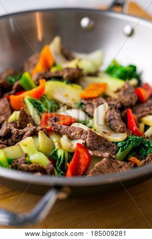 Beef Stir Fry close up. Healthy vegetable & beef stir-fry. Made with flank steak peppers onions and bok choy stir fried in an asian wok.