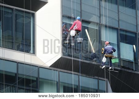 Moscow, Russia - May, 5, 2017: steeplejacks work in a center of Moscow