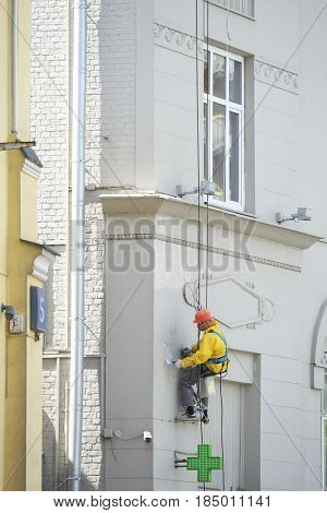 Moscow, Russia - May, 5, 2017: steeplejack works in a center of Moscow