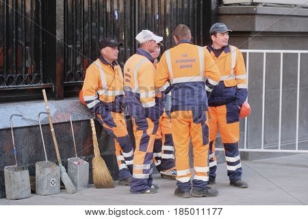 Moscow, Russia - May, 4, 2017: Municipal workers have a rest on Moscow street