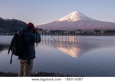 Photographer capturing Fuji mountain at Kawaguchiko lake in morning