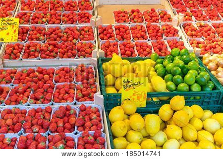 Strawberries, lemons and limes for sale at a market