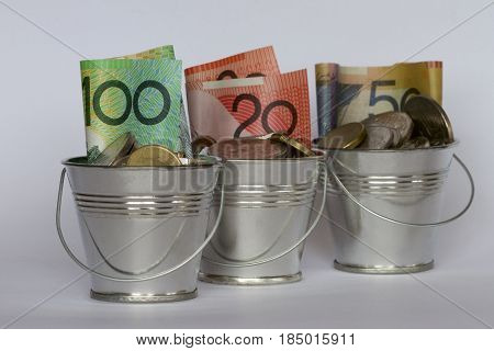 Three buckets of Australian dollars in a row.