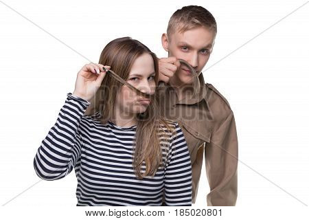 Fooling around woman and man in soldier's uniform on white background