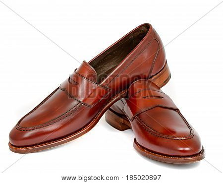 Pair of leather burgundy penny loafer shoes together on white background. Horizontal image