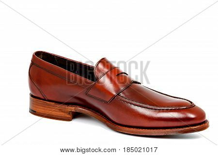 cherry calf penny loafer shoe toe to right on white background. Horizontal image