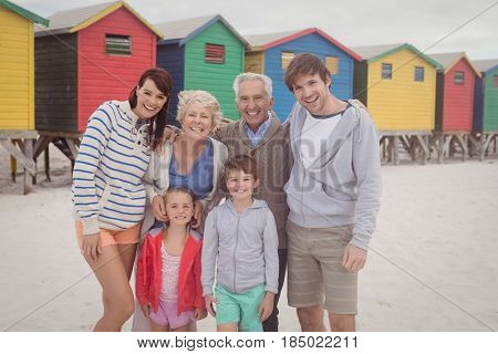 Portrait of multi-generation family standing at beach