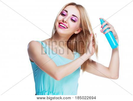 pretty happy woman with a hair spray isolated against white studio background