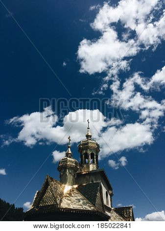 Golden Church domes on the background of blue cloudy sky