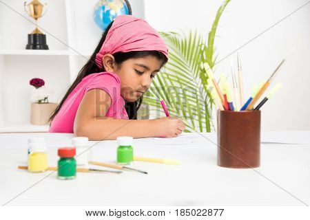 indian girl drawing, indian girl painting,asian girl colouring or drawing with sketch pen, indian girl and art and craft