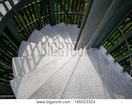 Top view silver color lighthouse spiral staircase.