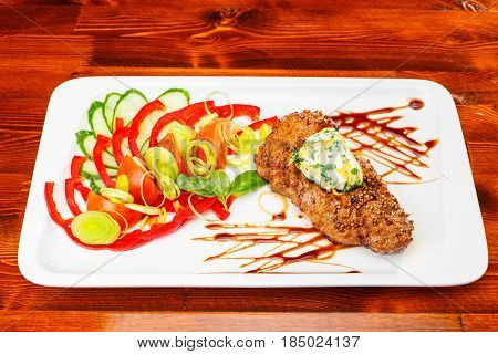 Rustic grilled beefsteak with french cheese an salad on wooden table