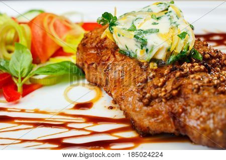 Rustic grilled beefsteak with french cheese an salad.