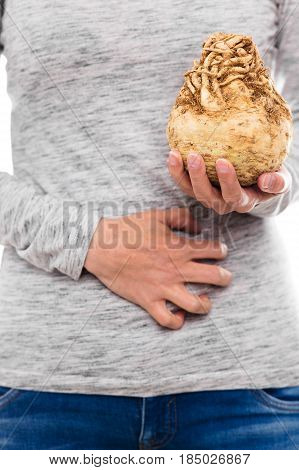 woman with celeriac allergy is having painful cramps