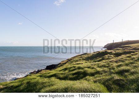 View of Irish Sea and Green Grassy Coastal Cliffs