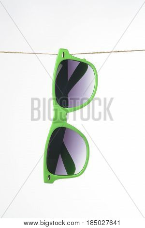 Sunglasses Hanging From A Rope