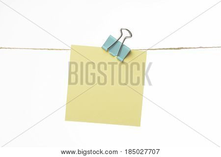 Note Of Paper Hanging On A Cord With A Clamp