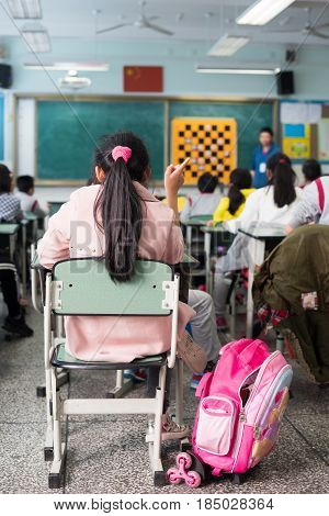 School Girl In A Chinese Classroom