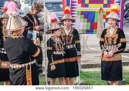 Penampang,Sabah-May 30,2016:Kadazandusun woman of Sabah in traditional costume taking photo by smartphone during Kaamatan festival in Kota Kinabalu,Sabah.
